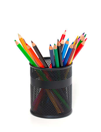 pencils in support over white photo