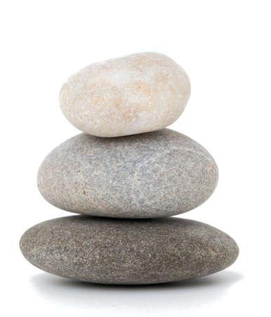 stack rock: stone pyramid over white Stock Photo
