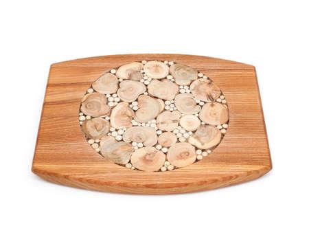trivet: decorated wooden trivet over white