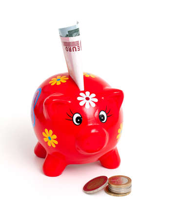 piggy bank and euros isolated on white background photo