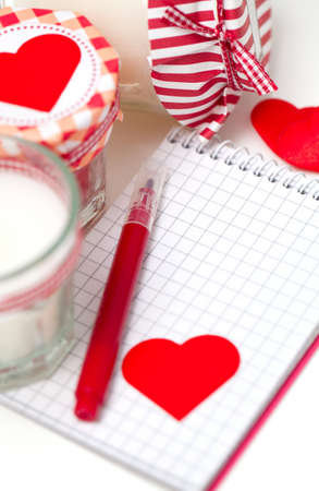 hearts, notebooks and candles over white photo