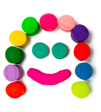 cilinder: smiley plasticine face over white