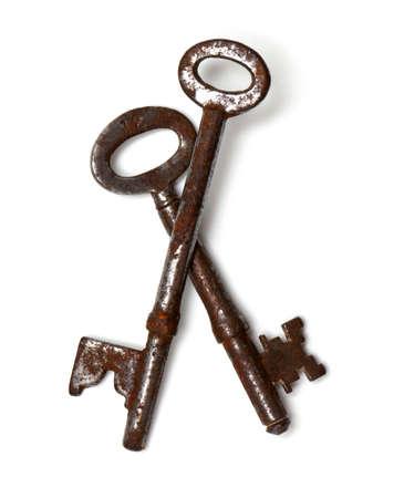 two old keys isolated on white background photo