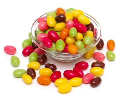 egg-shaped candies over white photo