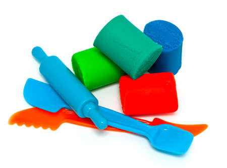 plasticine and tools isolated on white background photo