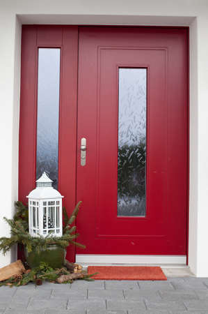 view of a wooden doorway: winter door exterior Stock Photo