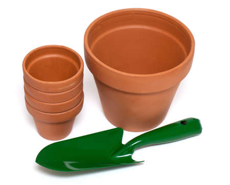 green garden showel and ceramic pots isolated on white background Stock Photo - 18246677