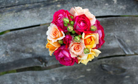 roses on wooden table, top view photo