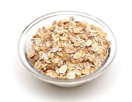 oat flakes in a glass bowl isolated on white backrgound photo