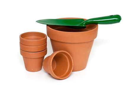 stainles steel: green garden showel and ceramic pots isolated on white background Stock Photo