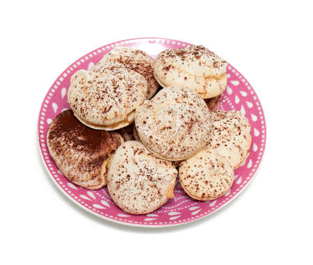 kiss biscuits: meringue with cocoa powder isolated on white backrgound Stock Photo
