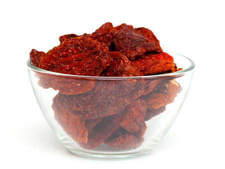domates: dried tomatoes in a glass bowl isolated on white background