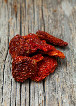domates: dried tomatoes on wooden background