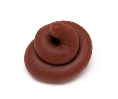 poo: plasticine poop isolated on white background