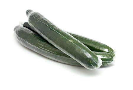 packed cucumbers isolated on white backrgound photo