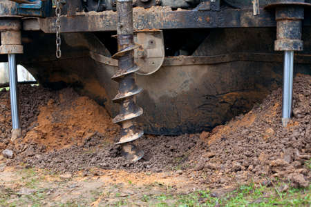 dug well: drill is digging a hole