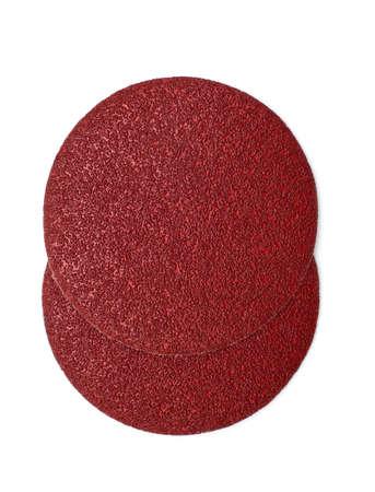 sandpaper: disk of brown sandpaper isolated on white background