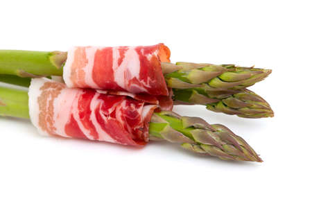 asparagus and proschiuto meat isolated on white background photo