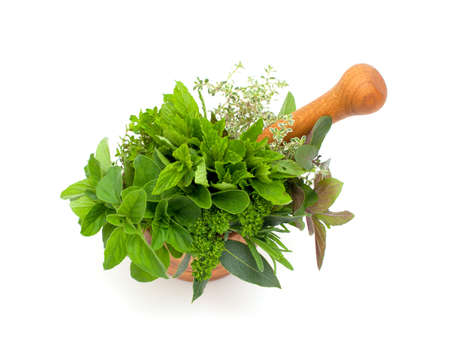 fresh herbs in a wooden mortar photo