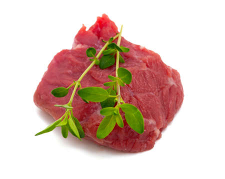 pieces of fresh beef isolated on white background photo