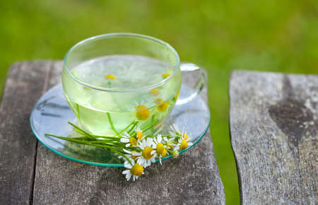 chamomile tea on wooden background photo