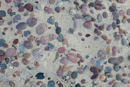 pebbles on beach sand photo