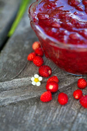 wild strawberry: wild strawberry jam on wooden background Stock Photo