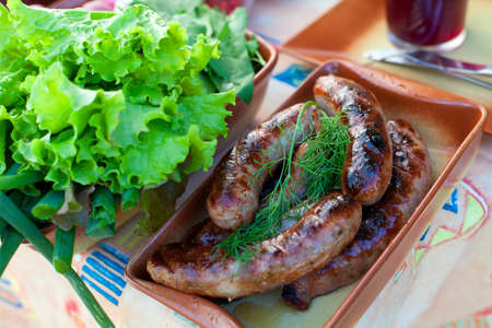 delicious grilled sausages photo