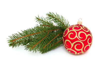 Christmas ball and twig of pine isolated on white background photo