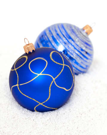 Blue Christmas balls on snow photo