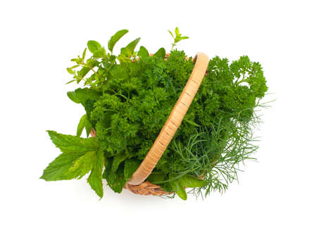 herbs in basket isolated on white, top view photo