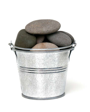 heap of sea stones in a bucket photo