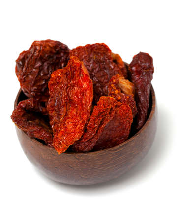 domates: dried tomatoes in a wooden bowl