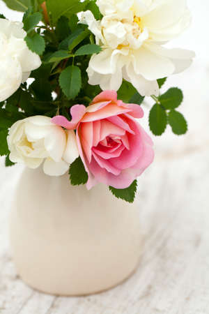 roses on wooden background  photo