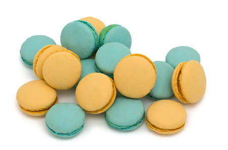 blue and yellow macarons over white photo