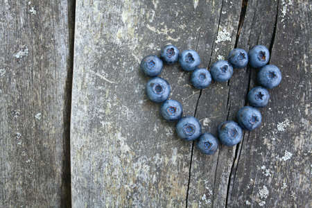 blueberry on wooden background photo