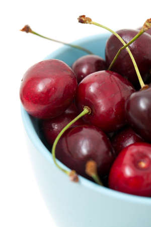 duet: cherries in a blue cup over white