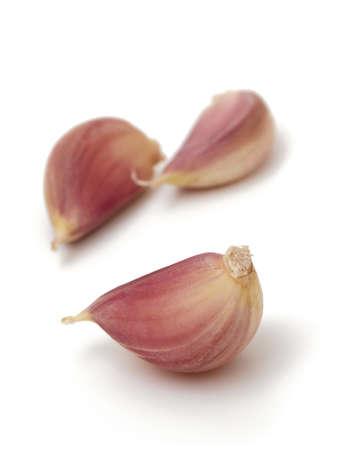 garlic cloves isolated on white photo