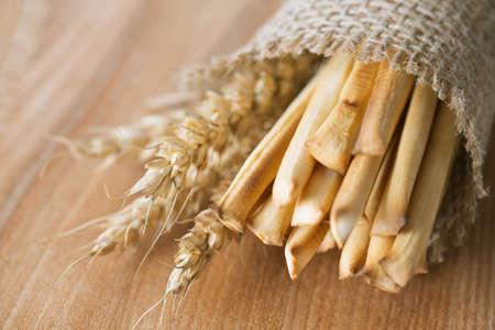 sesame cracker: bread sticks and wheat in burlap