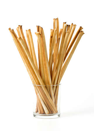 breadstick: bread sticks in a glass over white