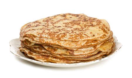 maslenitsa: fresh thin pancakes isolated on white