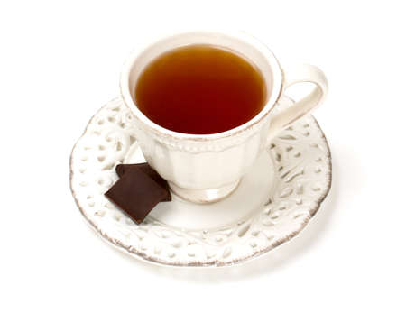 tea in vintage cup isolated on white photo