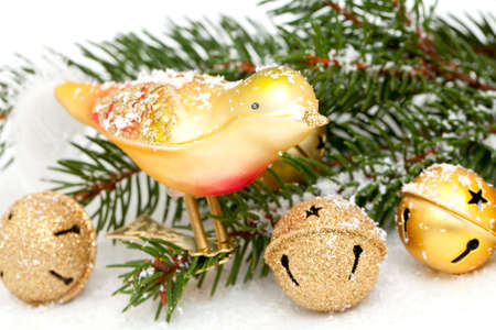 Golden bell baubles, birdy and twigs of pine photo