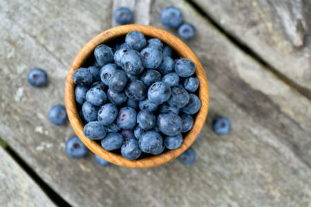 blueberries in a wooden bowl Stock Photo