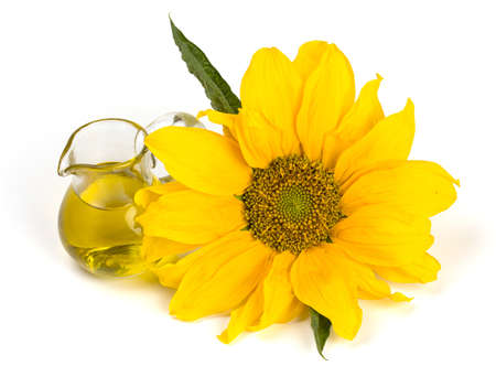 cooking oil: sunflower seed oil isolated on white