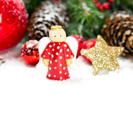 cute angel against Christmas decoration photo