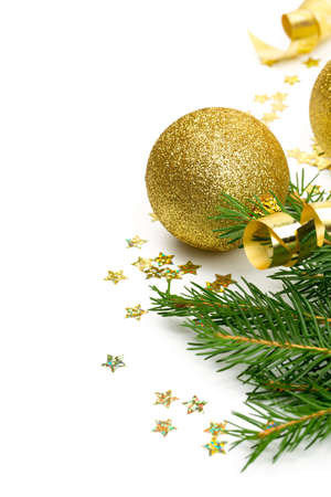 christmas fir: twigs of spruce, balls, confetti and ribbons isolated on white