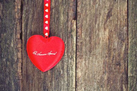 red heart on wooden surface photo