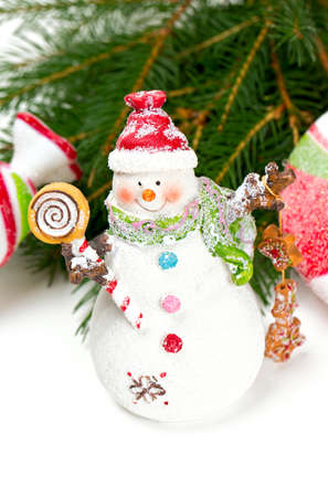 snowman with sweets isolated on white background Stock Photo - 22720364