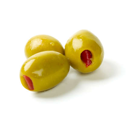 olive green: Green olives stuffed with red paprika isolated on white